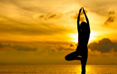 Silhouette of beautiful Yoga woman in morning